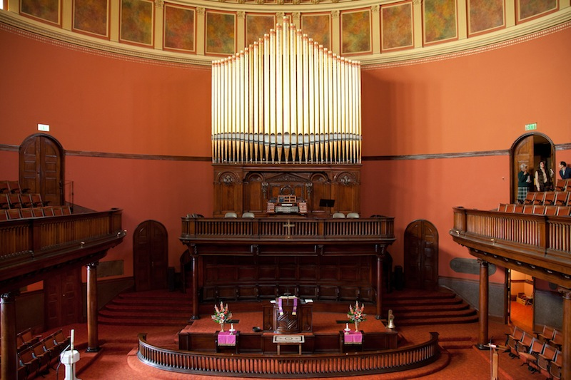 Central area, with the pulpit and the choir balcony behind it
